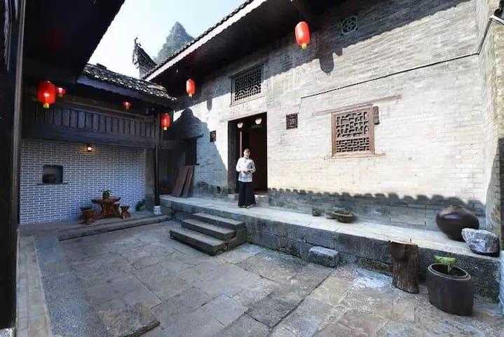 阳朔大宅门庭院酒店 - กุ้ยหลิน - บ้าน