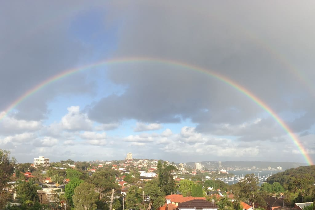 If it rains in the afternoon we usually have amazing rainbows.  This picture was taken off of our balcony.