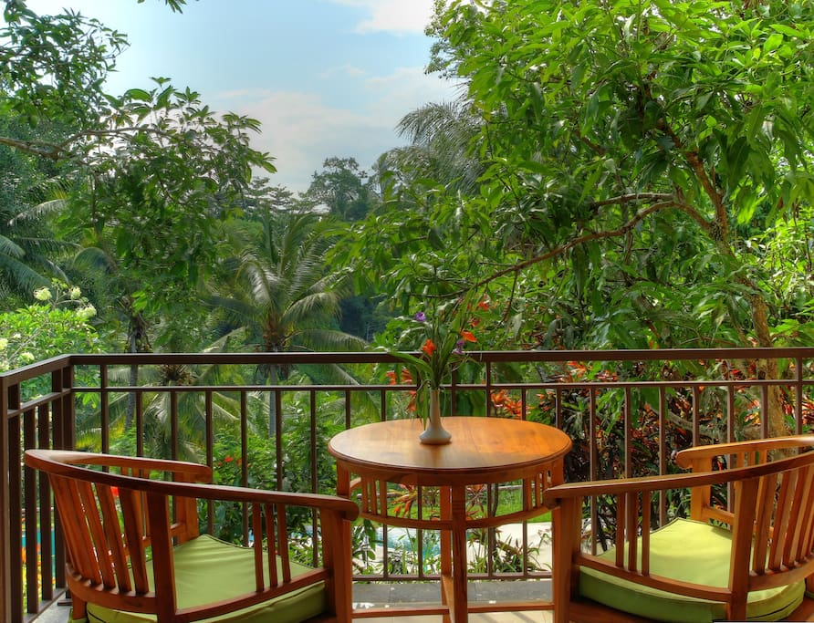 Balcony with view onto a lush forest