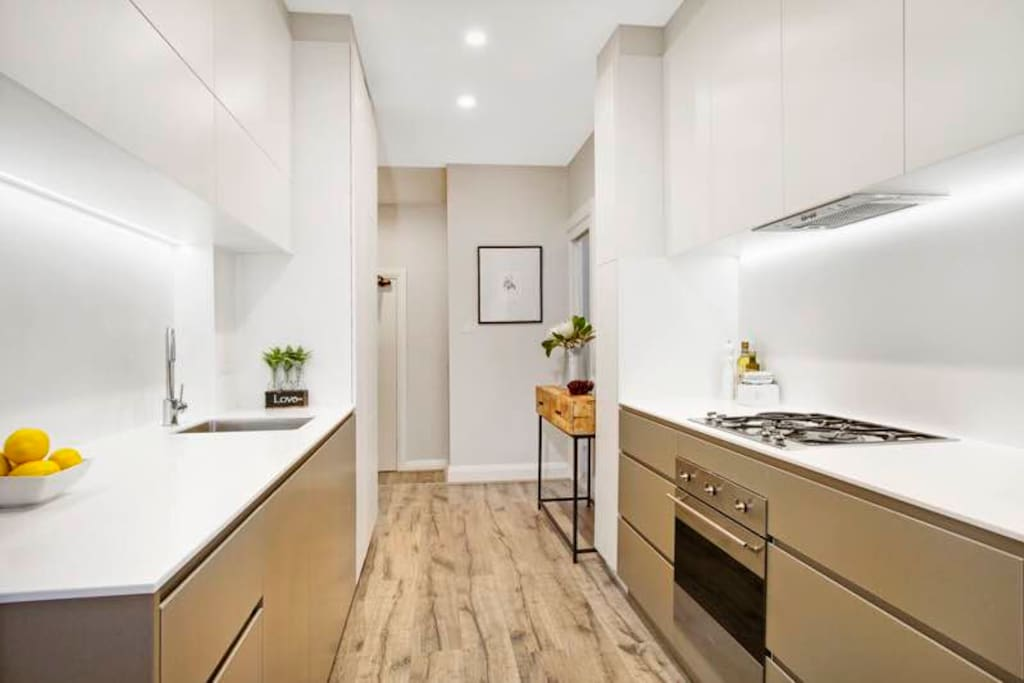 Beautiful NEW Galley kitchen with all new appliances. Gas cooktop, electric oven. The dishwasher and full size fridge-freezer are both integrated behind cupboards.