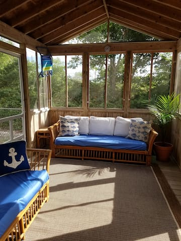 Fantastic screened in porch to relax, read a book or enjoy your morning coffee.