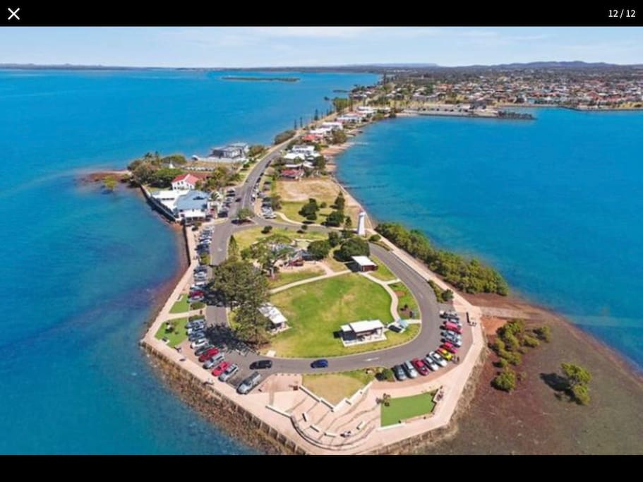 Aerial photo of Cleveland Point. 5 minute drive or an easy 20 minute walk to the best fish n chips in town then finish off with an ice cream and sit in the parklands and watch the world go by.