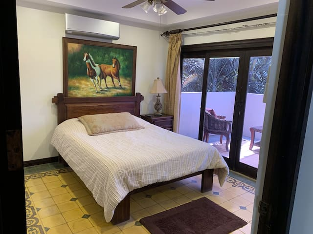 Second bedroom with queen size bed and patio
