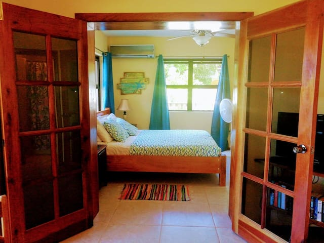Stretch out on a comfy Queen size bed in a cool air conditioned room.