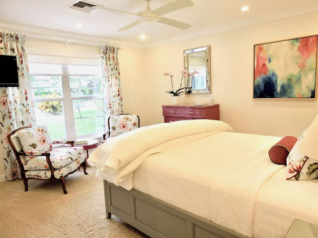 Lake Bedroom with queen bed and lake view.
