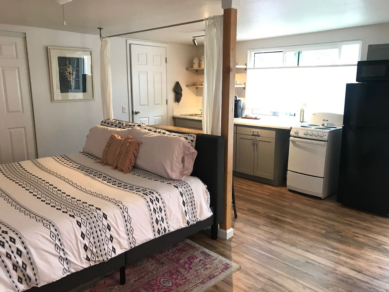 The Studio is approx. 350 sq ft with small bathroom, closet, kitchen with stove/oven combo, fridge, microwave, and Keurig. Countertop dining table with seating for four.