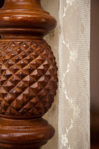 Detail in one of the hand carved canopy beds