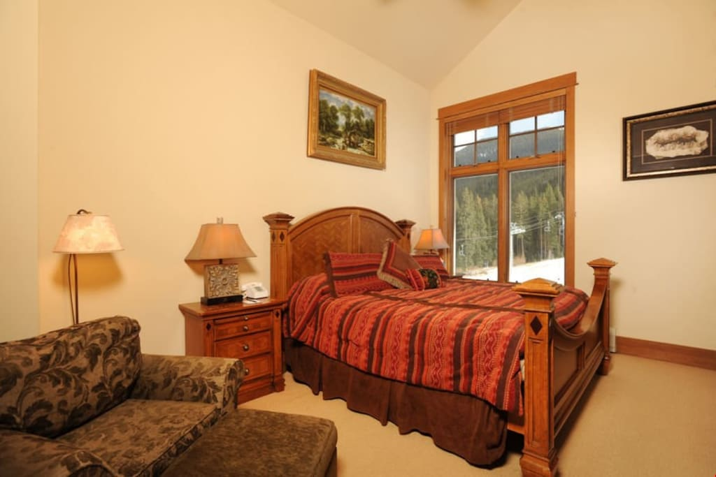 The master bedroom features a comfortable queen bed