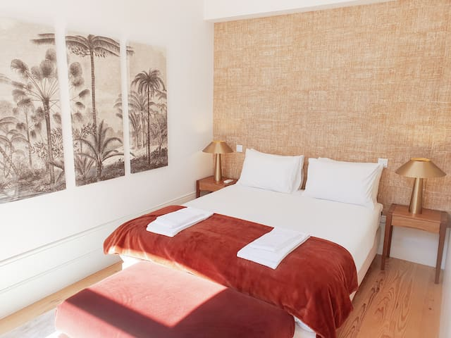 The stylish and comfortable bedroom with plenty of natural light and ventilation.