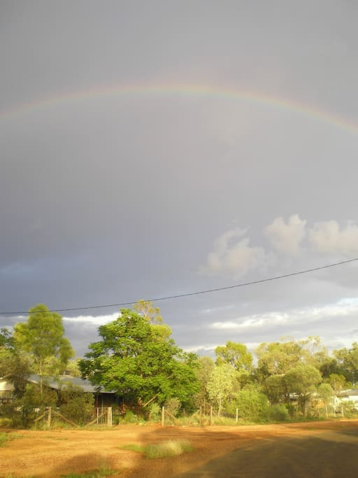 The Rock Shack with a the rainbow overhead.