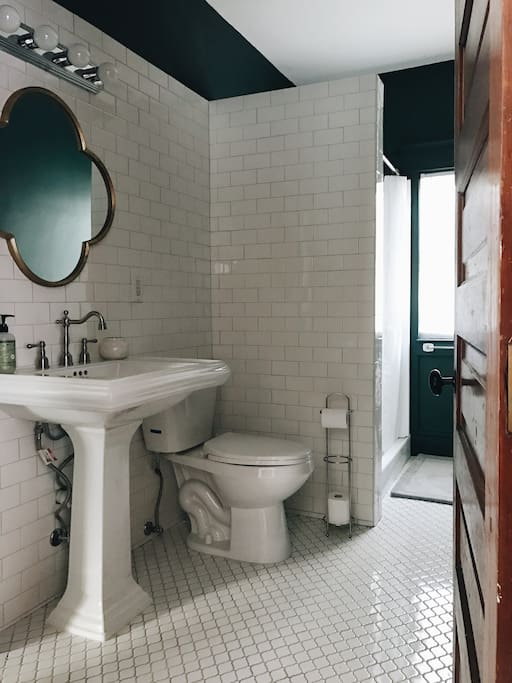 New updated bathroom with new fixtures and spacious Shower