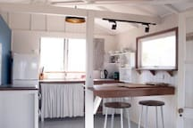 Kitchen area with full oven and cooktop - country charm