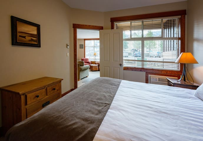 Master bedroom with a Queen bed and shared ensuite bathroom
