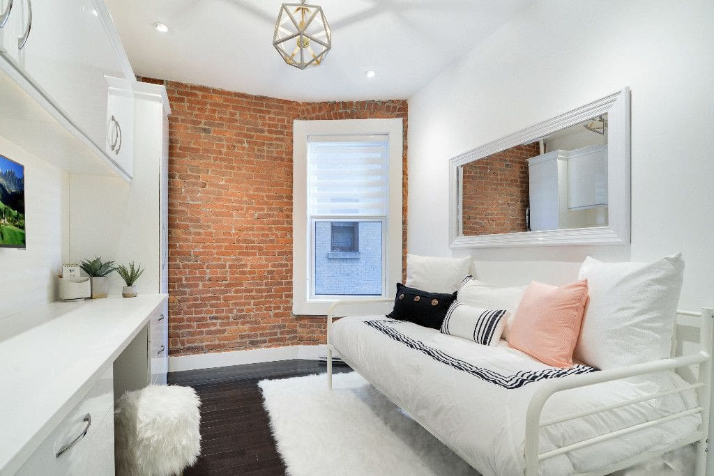 Bedroom with double closets, plush twin bed and extra mattress for second guest