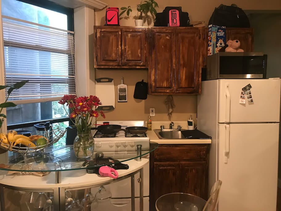 Shared full equipped kitchen and dining  bar