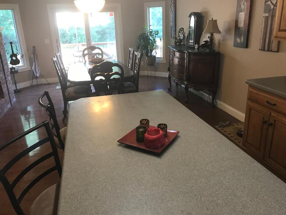 Nine seats in kitchen and dining area and connects to deck with large gas grill.
