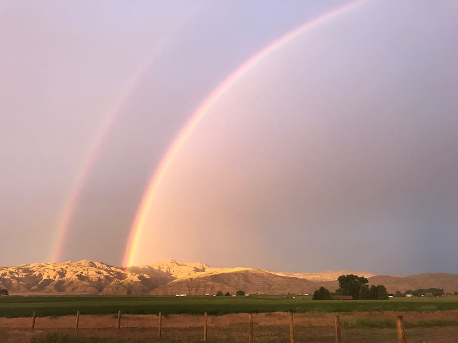 Evening rainbow over McCullough Peaks.  View from your door.