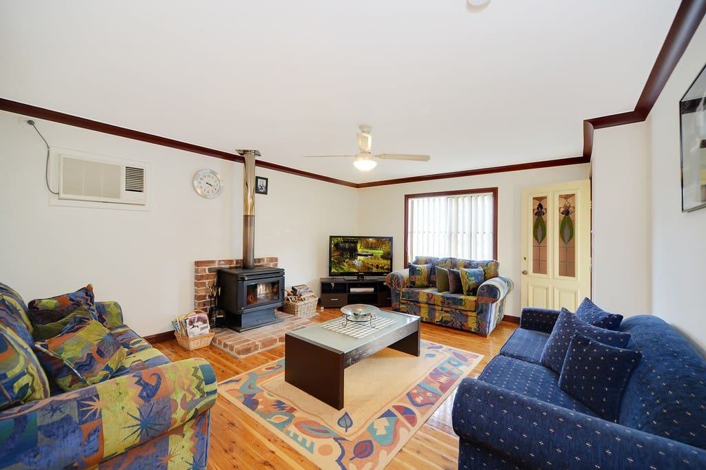 Inviting lounge room incl. 2 lounges (1 Sofa bed) large TV and working fireplace and air conditioning unit