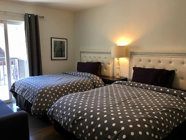 Two full size beds in one room