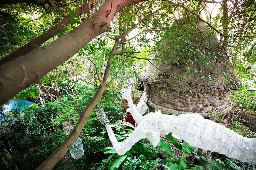 Tree House enshrouded in dreamy garden and work of arts