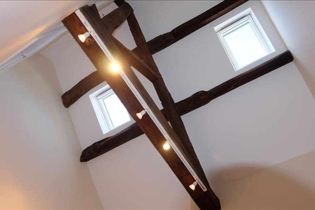 Bedroom - Looking up at the exposed beams & Velux