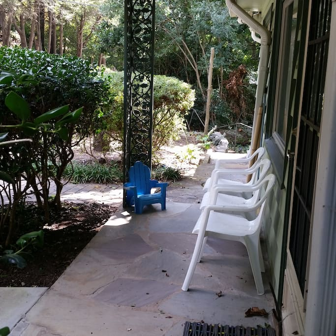 The front porch has seating for visiting.