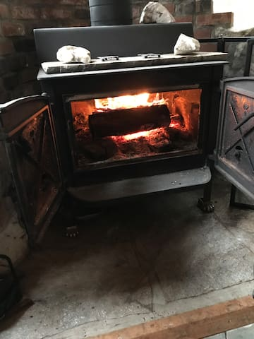 Wood burning stove in den gives off plenty of warmth