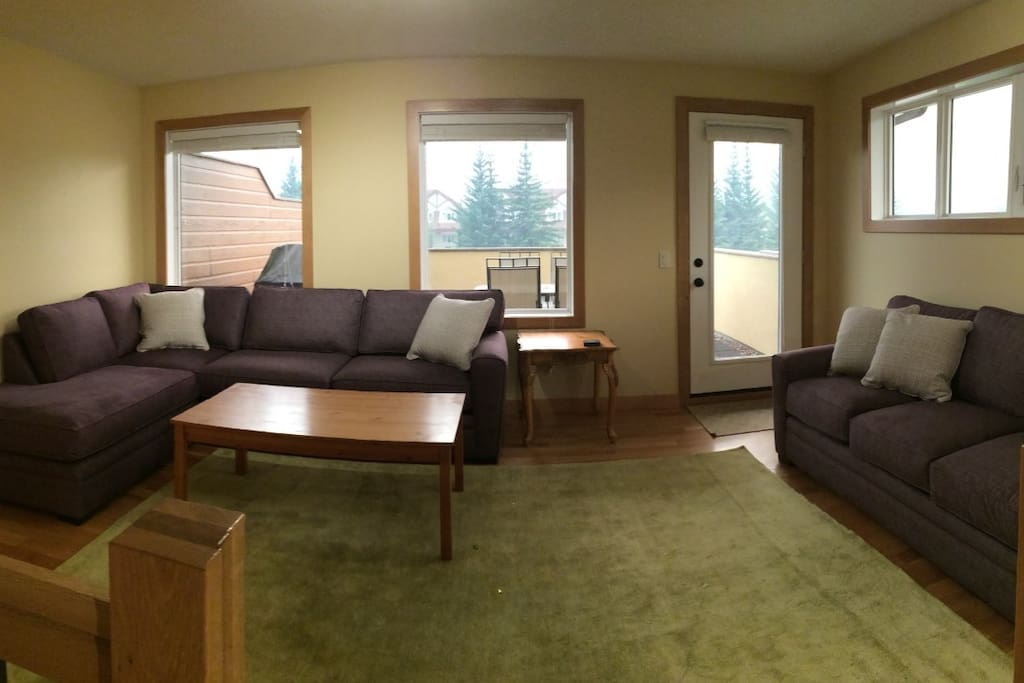 Large living room with incredible views of Ha Ling and Rundle Mountain ranges