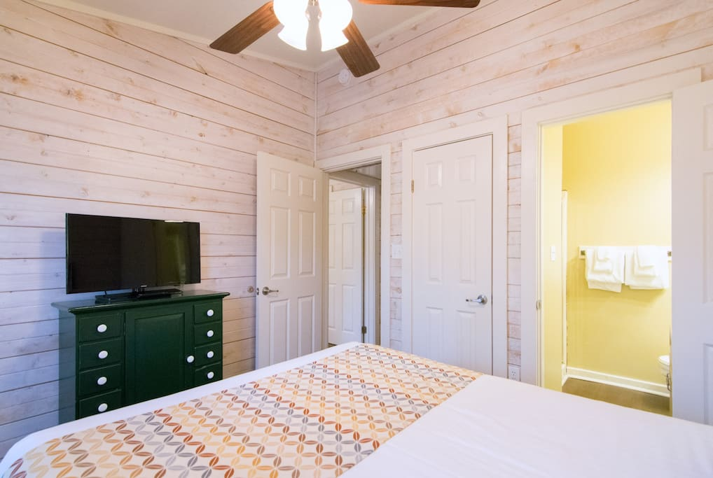 Guest Bedroom with TV & In-Suite Bathroom
