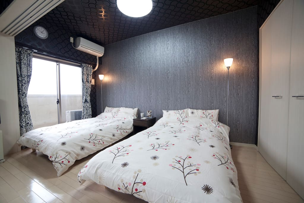 Large room with comfortable beds accommodates four adults.