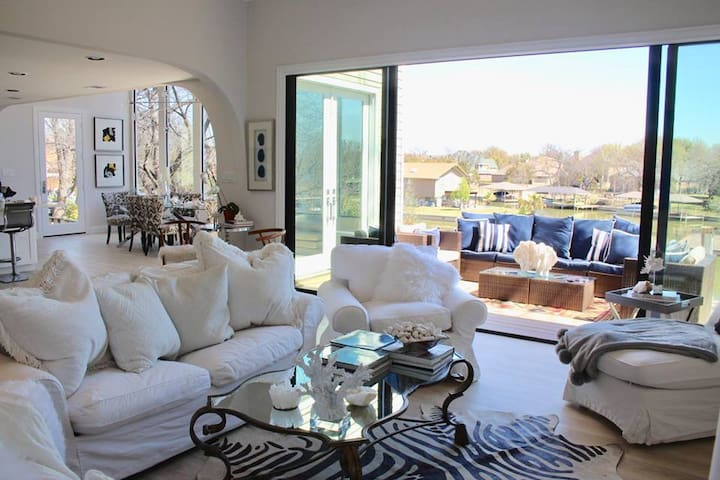 Living room with sofa bed.  Sliding doors lead to patio, back yard, and lake.