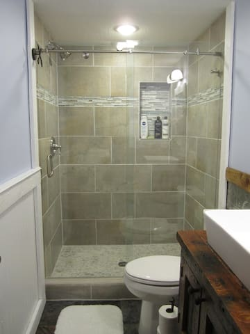 Brand new tile shower.  We will provide towels, shampoo, conditioner and soap.