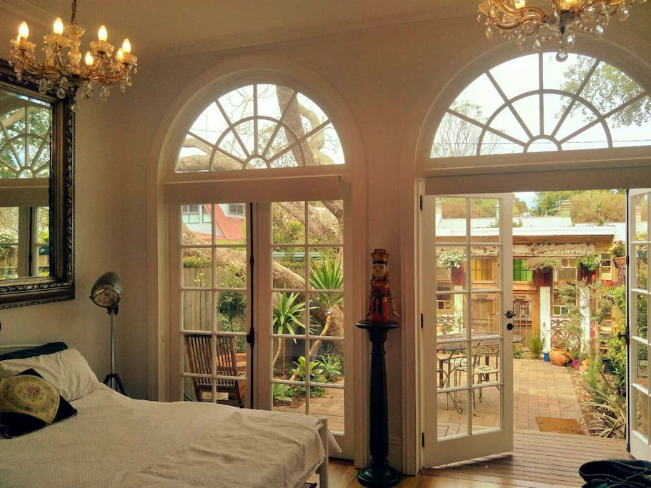 The bedroom has lots of natural light and feels cool and fresh