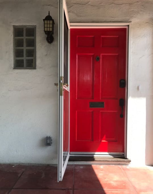 You can't miss the red door. Nice screen door allows view out and a breeze in!