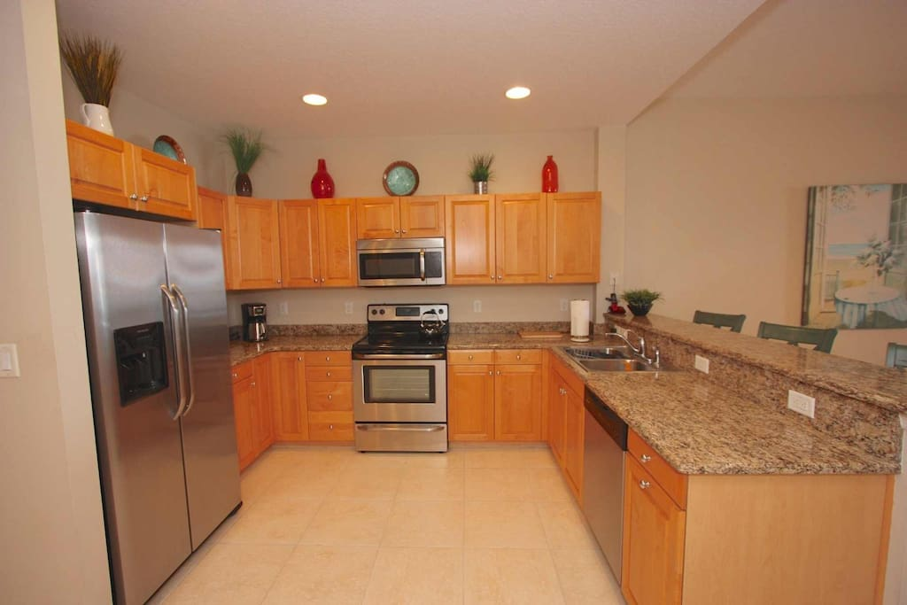 Spacious Fully Equipped Kitchen for Meals Large and Small-Breakfast Bar with Seating for 3-4