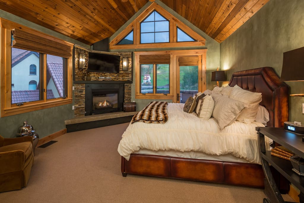 Casa Galena master bedroom King bed with stone fireplace and private deck.