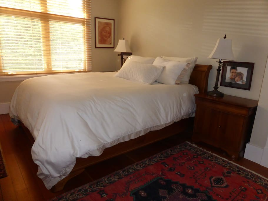 Queen size bed with luxury mattress in quiet master bedroom, new bedding and pillows. Large walnut wardrobe, cedar drawers available and empty for your use