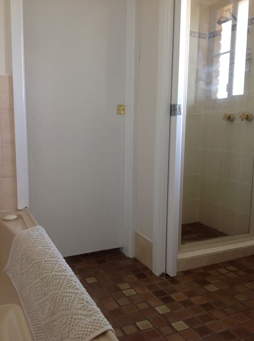 Shower and toilet are in separate rooms