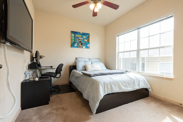 """Your bedroom with queen size Tempurpedic mattress, 50"""" plasma TV,  Roku Express, work desk with 24"""" Monitor and more."""