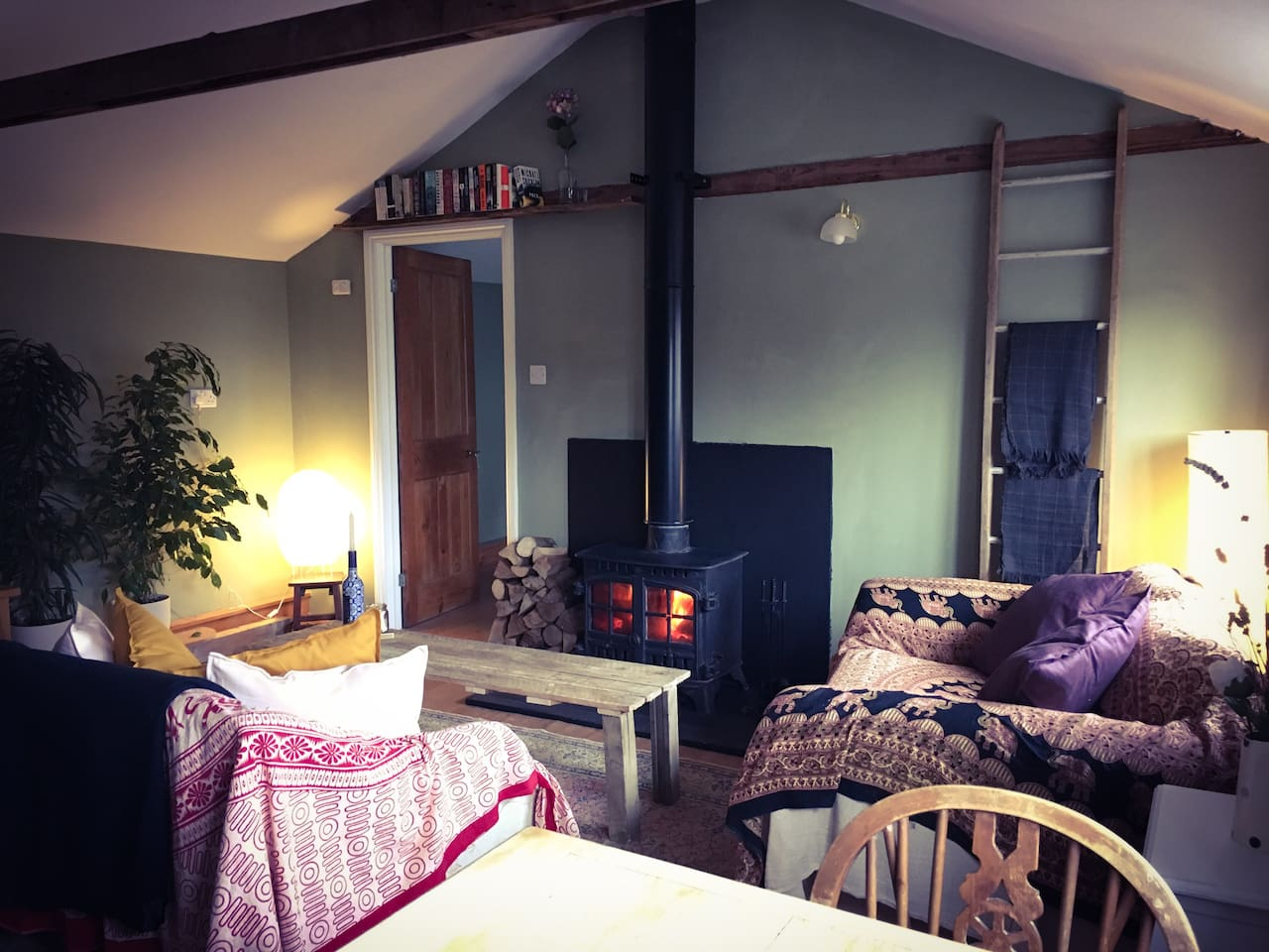Living room with a very warm wood stove.