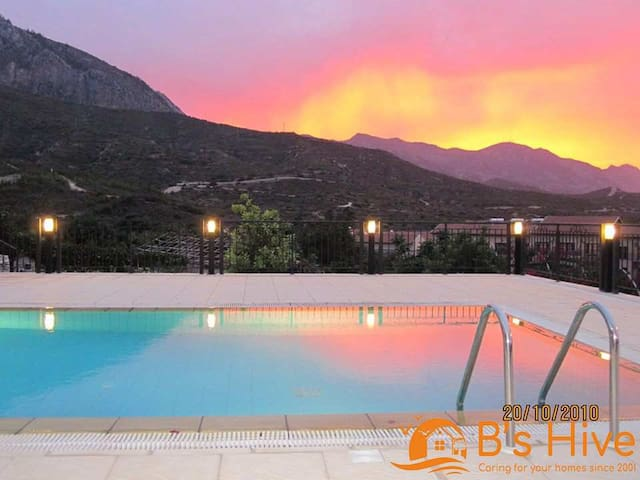 Enjoy stunning sunsets by the pool with sea and mountain views