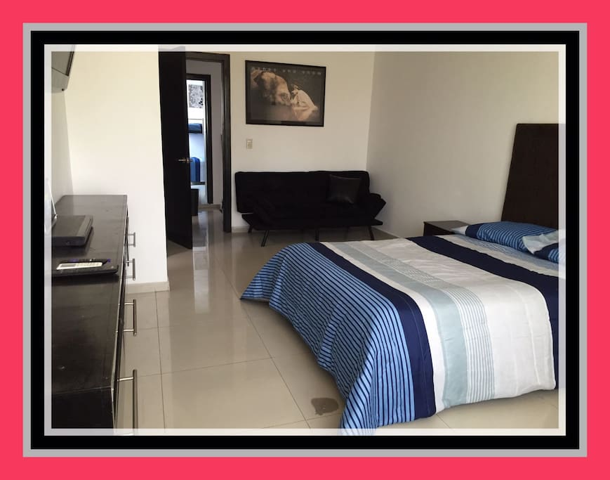 Principal Bedroom, with Air Conditioner, walking in Closet, privated Bathroom and Sofa Bed.