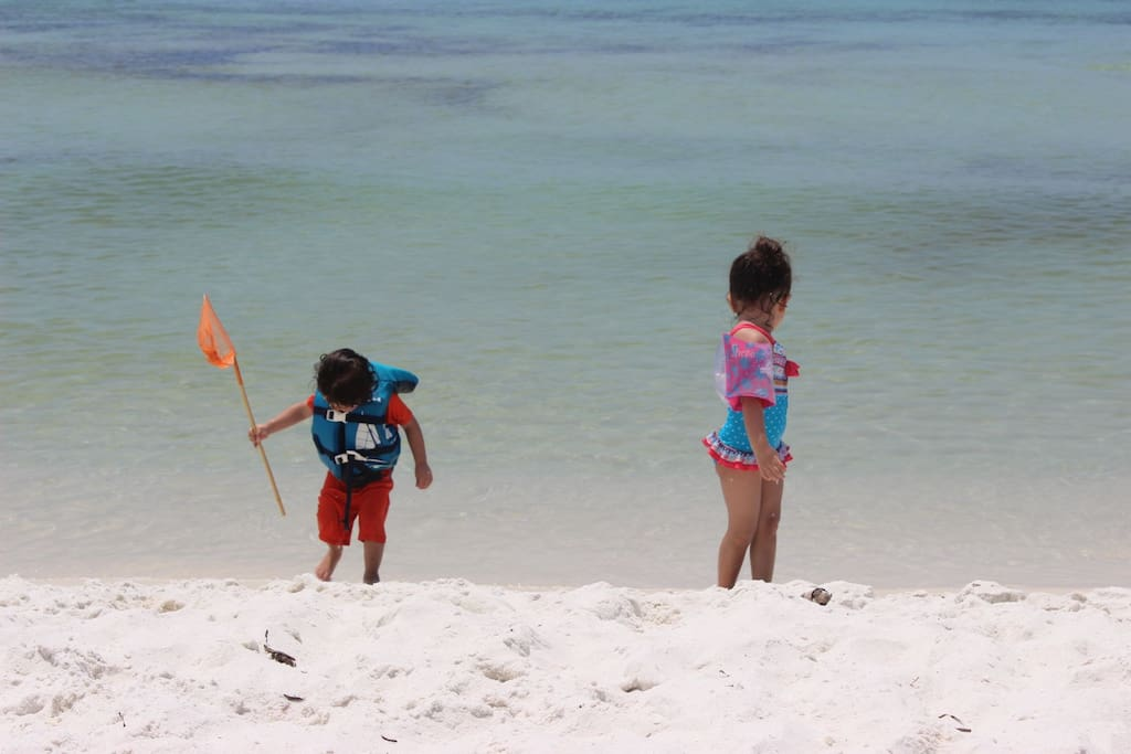 Twins playing on the Gulf