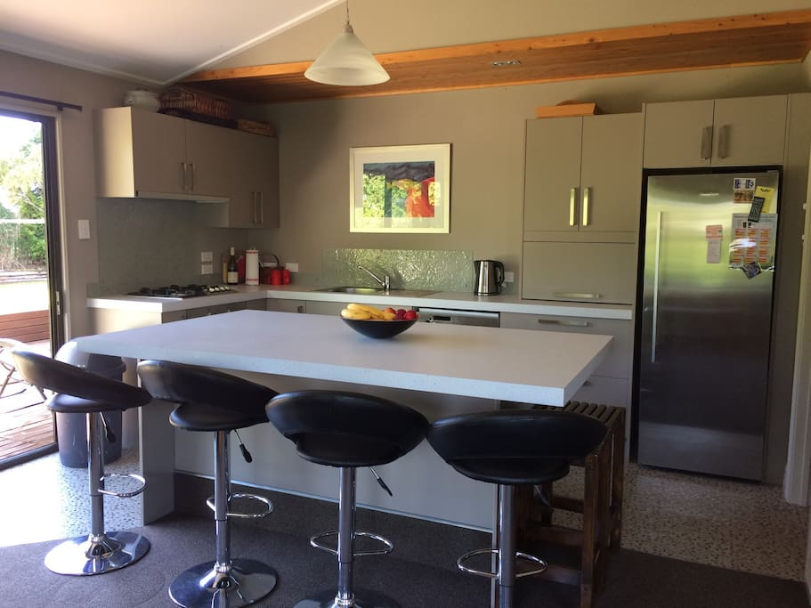 Modern kitchen with all the essentials, gas cooktop/full fridge/dishwasher