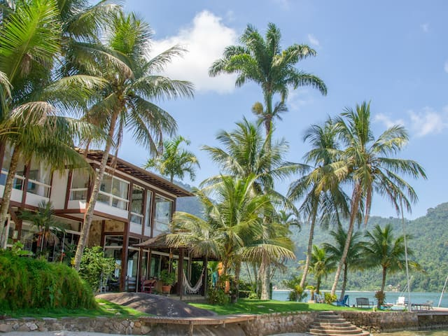 Get close to the water and the private beach at Villa Palm Angra.