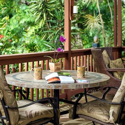 Mala Hale Bungalow's private lanai.  Relax and enjoy a new book or simply take in nature.