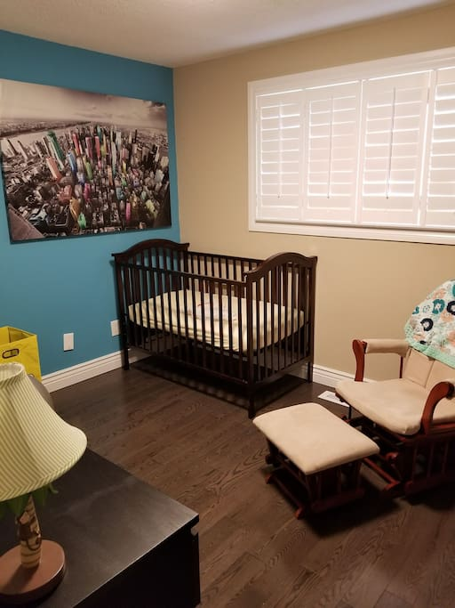 Nursery - can replace with air mattress if crib not needed.