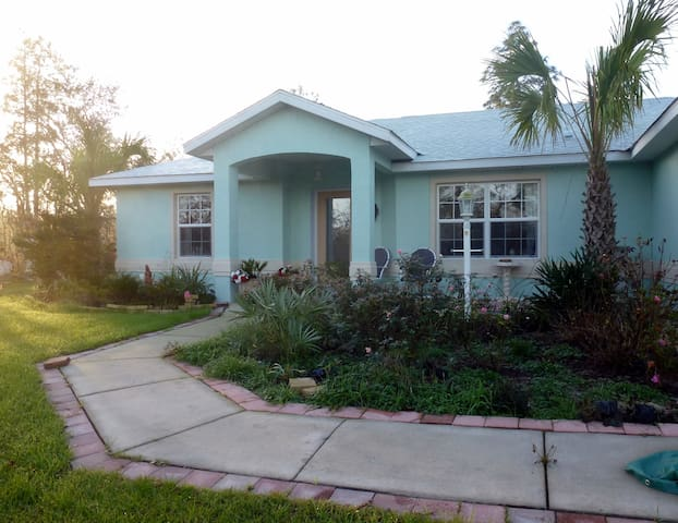 2007 modern concrete block/stucco home on acre lot in countryside. Smoking on shaded front paved patio only