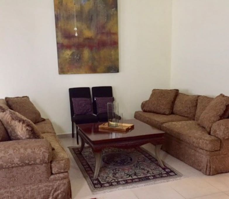 Gorgeous Living Room, with two sofas with a cofee table and a pair of chairs.