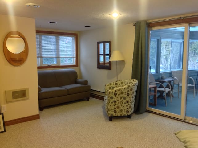 The spacious bedroom with private screen porch